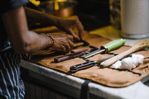 Black Chef sorting kitchen utensils