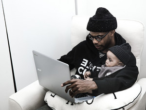 black father holding baby