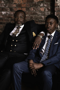 black father with sons in a family photo