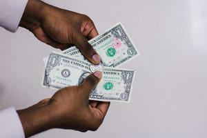 black hands holding money
