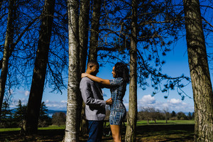 Black male and female hold each other for engagement pictures