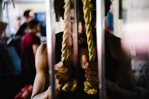 Black man does a rope exercise in a crossfit gym