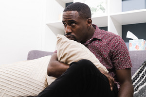 Black man listening during therapy session