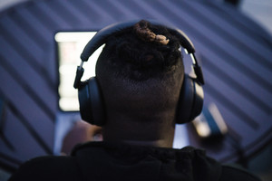 Black man listening to music with headphones