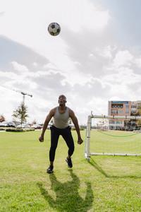 Black man playing soccer