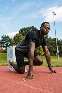 Black man preparing to run on stairs