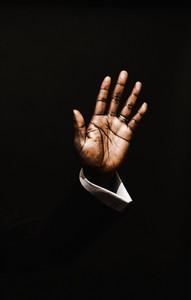 Black man raising hand in praise
