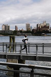 Black man running on the pier