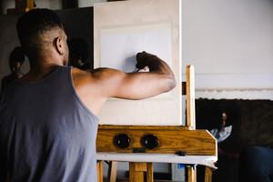black man sketching