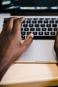 Black man typing on the computer
