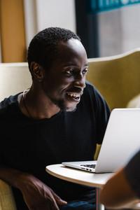 Black man using the computer