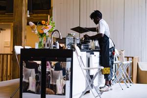 black man wearing apron working at restaurant