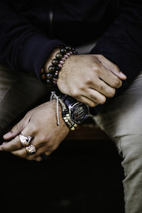 black man wearing watch and jewelry