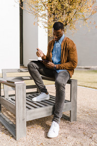 Black man writing in notebook