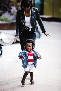 Black mother chasing black son