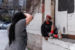 Black Photographer taking photo