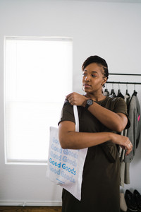 Black woman holding shopping bag