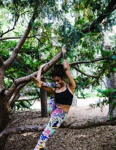 black woman smiling during yoga pose