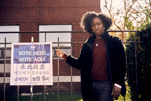 Black woman standing in line to vote