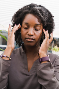 Black woman thinking intently in therapy session