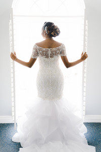 bride in a veil and white poofy dress
