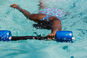 Child swimming in in pool