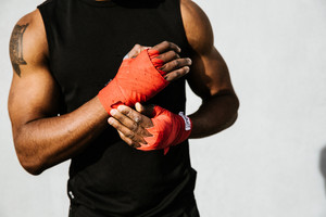 close up of muscular black man roped hands