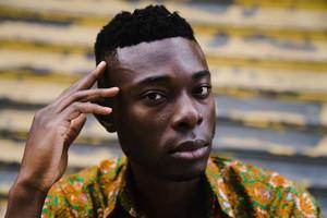 closeup of black man's face staring into camera