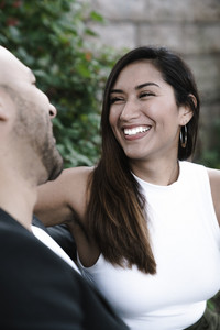 couple laugh and smile in romantic moment