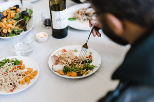 dinner party with wine and fresh food