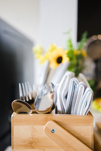 display of cutlery in wooden bowl