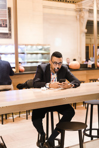 East African man sitting at table