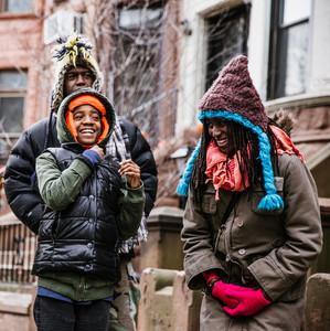 Family outside in winter coats