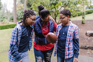 family play football outside