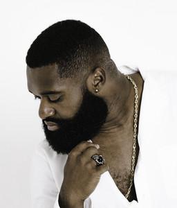 fashionable man touches his beard