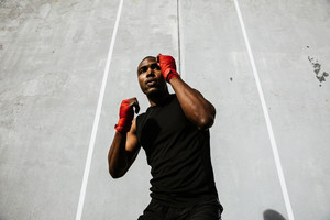 fit black boxer punching air