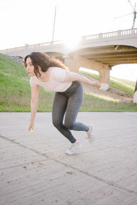 fit woman gets into a running position