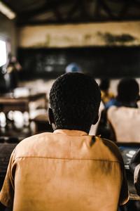Ghanaian boy sitting in school room