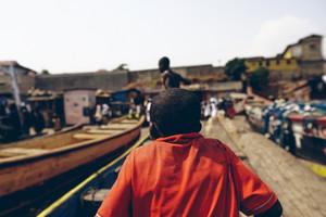 Ghanaian people near boat dock
