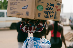 Ghanaian woman holding box on head