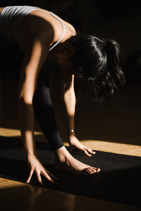 graceful female yogi performs yoga in a studio