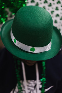 green St. Patrick's Day leprechaun hat with four leaf clovers
