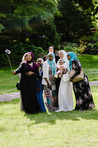 group of muslim women of all shades pose for a selfie