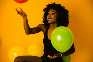 Guyanese woman playing with balloons