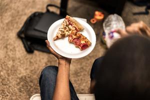 half eaten slices of pizza