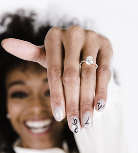 happy woman shows off her new engagement ring