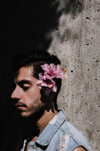 Iranian man leaning against the wall