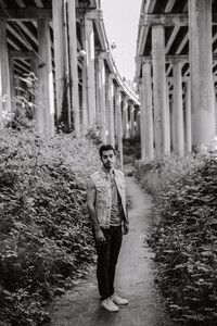 Iranian man standing under bridge