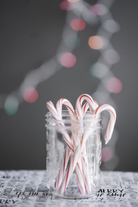 jar of candy canes with festive holiday decor