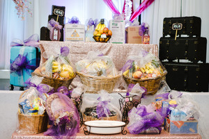 Large Easter baskets filled with fruit and wrapped in purple ribbon set up at for a party